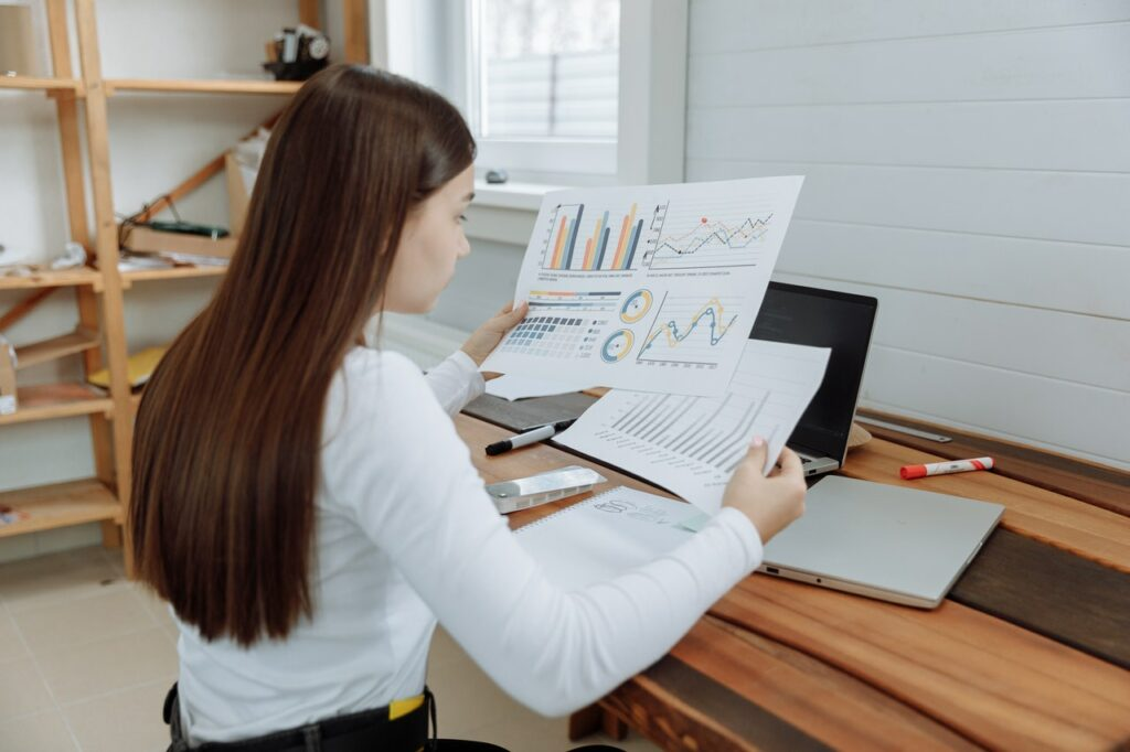 woman looking at project documents at a desk